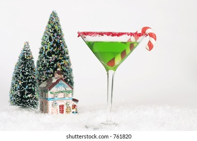 Winter Cocktail - Alcoholic drink and snow scene with a Christmas theme