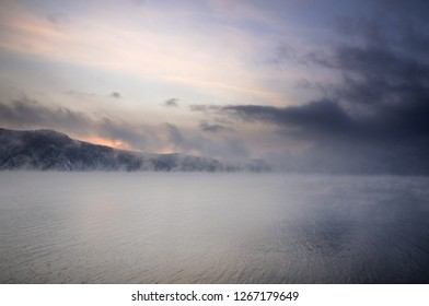 Winter cold foggy dawn on the Yenisei river near Krasnoyarsk in Siberia, Russia