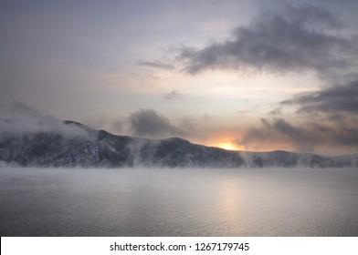 Winter cold foggy dawn on the Yenisei river near Krasnoyarsk in Siberia, Russia