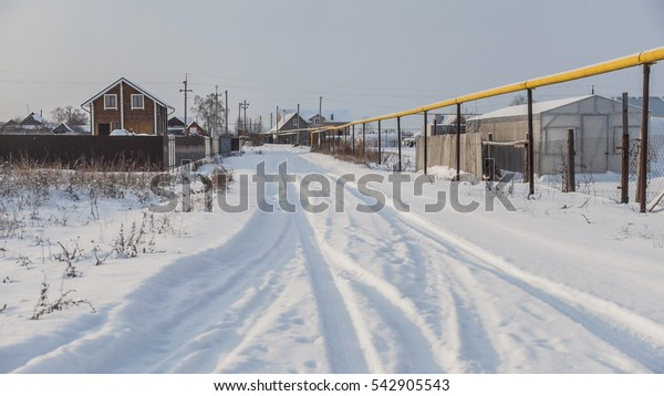 Winter countryside Russian - village in center of Volga, snow cold day, wide angle
