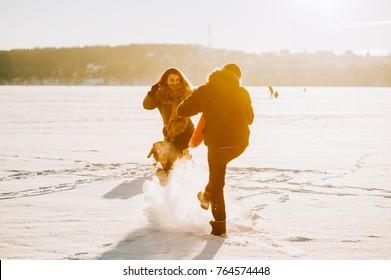 winter couple in love, walk on frozen lake