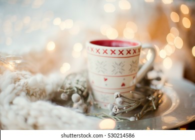 winter cup and Christmas decorations