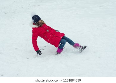 Winter danger, the girl slipped and falls.