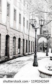 Winter day in Mainz in Germany.  The streets of Mainz in the snow. Buildings, road and street lamp in snow