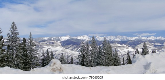 Winter day with snowy hills, blue sky,  above Vail Valley,Colorado