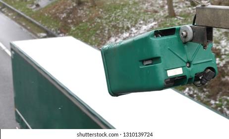 winter day view average speed traffic camera under falling snow over UK Motorway