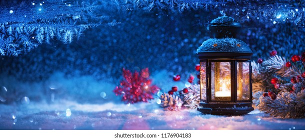 Winter Decoration with a Candlestick Near the Snow-Covered Window. Christmas Background