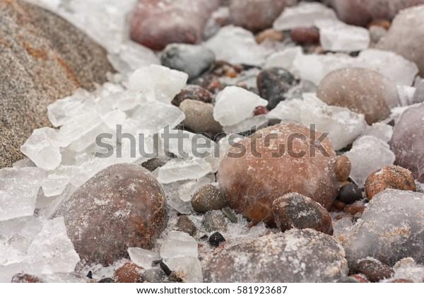 Winter draws on sea rocks patterns and icicles, Russian Kaliningrad
