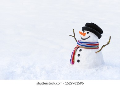 Winter dream of children. Funny snowman with a colorful scarf. Copy space for text