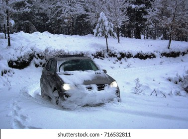 WINTER DRIVING CAR IN THE SNOW