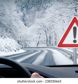 Winter Driving - Caution Snow - Curvy snowy country road