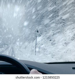 Winter Driving - Heavy snowfall on a country road.
