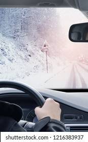 Winter Driving - Driving on a snowy mountain road