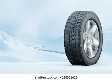 Winter Driving - Winter Tire - Winter tire in front of a snowy mountain landscape. Computer generated image