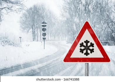 winter driving - winding country road in winter - risk of snow and ice