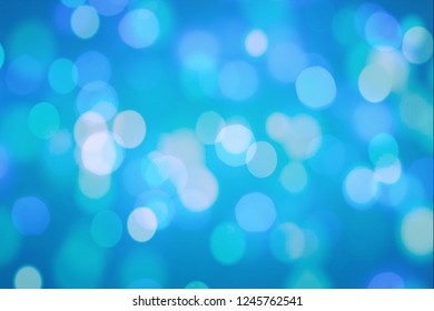 Winter elegant bokeh background. Seasonal cooling light decorative abstract design element.