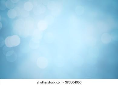 Winter elegant bokeh background. Seasonal cooling light decorative abstract design element.