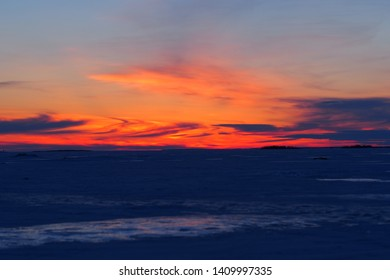 Winter evening by the frozen sea , Oulu, Finland