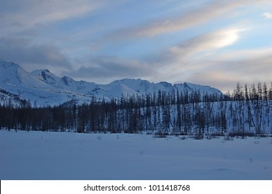 Winter evening in the mountains on the lake.