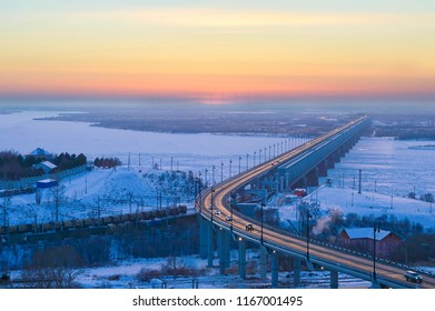Winter evening on the Amur bridge. Trans siberian railway. Khabarovsk, far East, Russia.