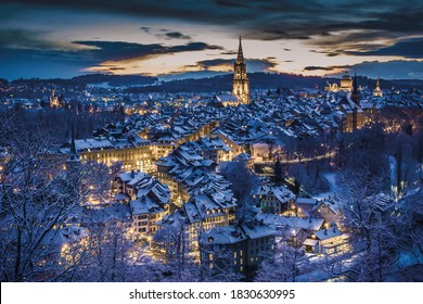 Winter evening sunset with snowy and illuminated buildings, Rosengarten, Bern, UNESCO, Switzerland