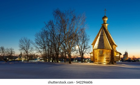 Winter evening in Suzdal, Russia. The wooden Nikolskaya Church in Suzdal Kremlin in the light of illumination.