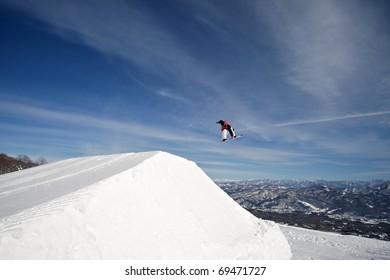 Winter extreme sport snowboarder