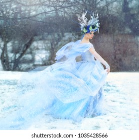 Winter Fairy, Snow queen - woman in light blue tulle dress outdoor wear floral crown