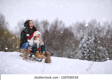 Winter fairy tale, a young family in the forest.