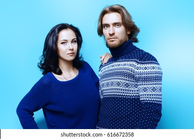 Winter fashion. Handsome man and beautiful brunette woman in sweaters posing together.