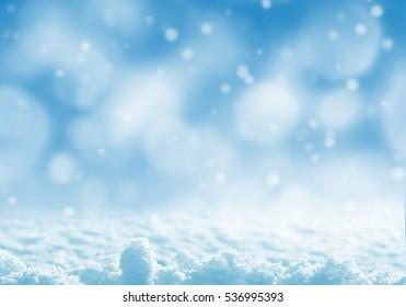 Winter festive background. Winter landscape with brilliant snow in the sunlight.