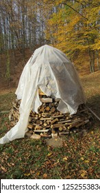 winter firewood covered with plastic sheet