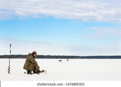 winter fishing Fisherman enjoying a day on the ice