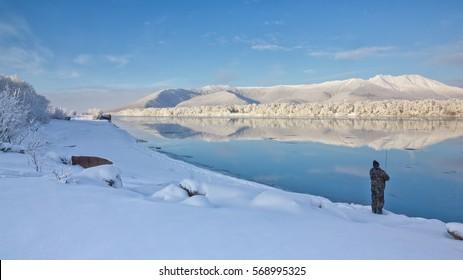 Winter fishing on the Kamchatka River. Harchinsky ridge.
