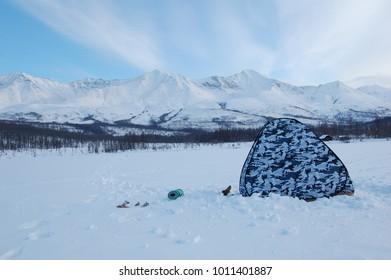Winter fishing on a mountain lake.