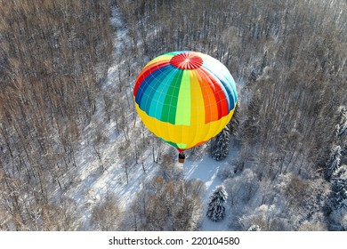 Winter flight above the forest on the balloon