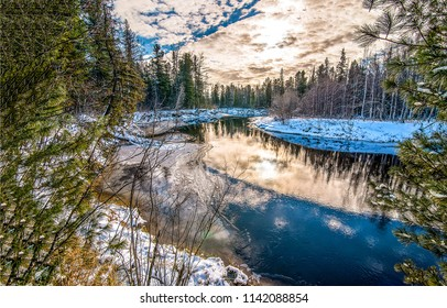 Winter forest river reflection landscape. River reflection in winter snow forest panorama. Winter snow forest river view