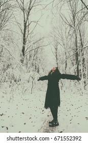 Winter frost. Beautiful woman in a fur coat