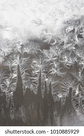 Winter frosted window at winter