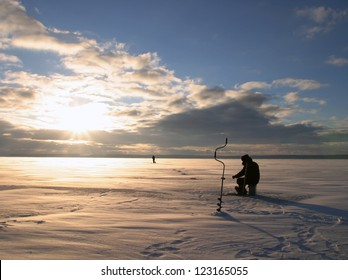Winter frosty morning fishing on the river