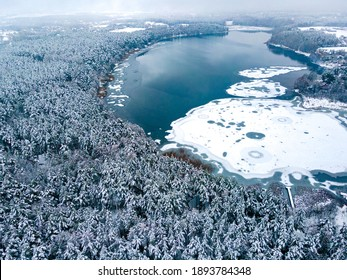 Winter. Frozen lake covered by the snow.