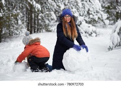 winter fun. a girl and a boy making snowballs