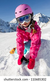 Winter fun - happy skier playing in snow