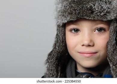 Winter fur hat clothing boy on grey background