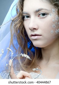 winter girl with beautiful make up on blue background