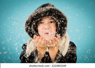 Winter Girl Blowing Snow from Hands, Isolated in Studio