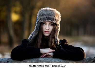 Winter. Girl in cold weather. Beautiful girl in the winter outdoors. Woman in winter cap.