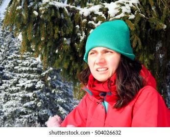 winter girl having fun in the mountain snow