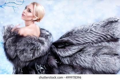 Winter Girl in Luxury Fur Coat. Fashion Fur. The blonde in a long gray coat. Fluffy gray fur coat