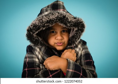 Winter Girl Shivering in the Cold, Isolated in Studio